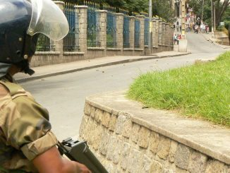 a-riot-police-officer-stands-guard-during-a-demonstration-by-opposition-supporters-in-antananarivo_5998504.jpg
